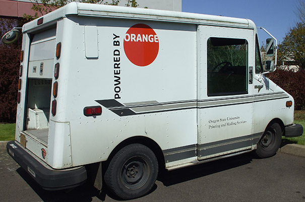 powered by orange mailing truck